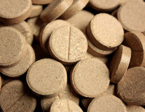 Vitamins 2. Closeup of brown vitamins or food supplements Royalty Free Stock Photos