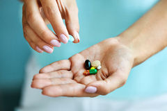 Free Vitamins And Supplements. Female Hand Holding Colorful Pills Stock Image - 84238951