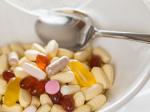 Vitamins in bowl of tablets Royalty Free Stock Image
