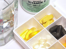 Vitamins in a box. Photo of assorted vitamins in a box Stock Photography