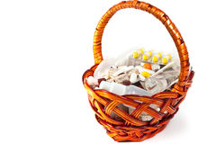 Vitamins in brown basket Royalty Free Stock Image