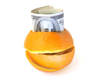 Vitamins for business. 100 dolars banknotes in an orange peel Stock Photos