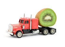 Vitamins cistern. Toy truck representing fruit juice cistern royalty free stock images