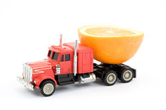 Vitamins cistern. Toy truck representing fruit juice cistern stock images