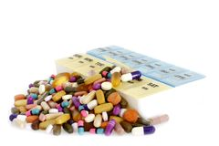 Vitamins, Drugs Overflowing a Pill Box royalty free stock photos