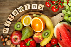 Vitamins in fruits and vegetables Stock Images