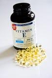 Vitamins Gel Pills. Gel pills of Vitamins E with plastic bottle isolated on white Stock Image