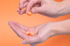 Vitamins in hand Stock Photography