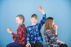 Vitamins are important for childrens health. Little children biting red vitamin apples. Small children enjoy eating. Apples full of vitamins. Vitamin does a royalty free stock photography