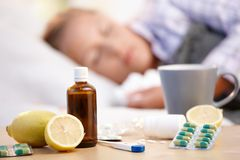 Vitamins medicines for flu woman in background Stock Photos