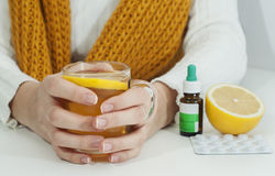 Vitamins, medicines and hot lemon tea. For a woman who got caught Royalty Free Stock Photo