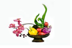 Vitamins and orchid. Arrangement from artificial silk colors an orchid with vegetables Stock Images