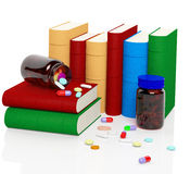 Vitamins and pills with books Royalty Free Stock Images