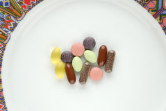 Vitamins on a Plate. A dose of vitamins and minerals on a plate. Seen from above Stock Photography