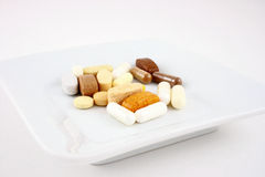 Vitamins plate. Bunch of vitamins in a plate Royalty Free Stock Images