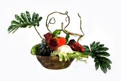 Vitamins and roses. Arrangement from artificial leaves, colors and vegetables Royalty Free Stock Image