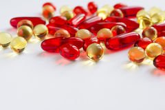 Vitamins scattered on a white background Royalty Free Stock Image