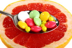 Vitamins on a slice of citrus. Vitamins on a slice of citrus on a white background Stock Photography
