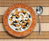 Vitamins soup. A view with some drugs and vitamins in a plate Royalty Free Stock Photography