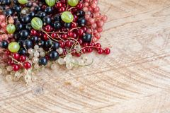 Vitamins. Summer berries. Red currant background. Close up, selective focus. Harvest Concept. Vitamins. Summer berries. Mix of ripe organic Red, black, rose stock photography