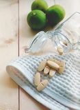 Vitamins and supplements in the bottle on wooden table. Vitamin C concept,vitamin C bottle Royalty Free Stock Image
