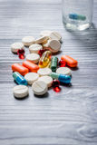 Vitamins and supplements. Pills and pill bottle on grey wooden table background copyspace Royalty Free Stock Photo