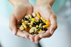 Vitamins And Supplements. Woman Hands Full Of Medication Pills Stock Photos