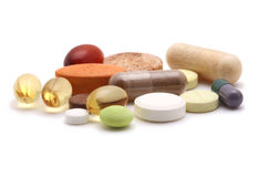 Vitamins, tablets and pills Stock Images