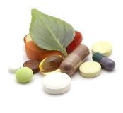 Vitamins, tablets and pills on leaf Royalty Free Stock Photography