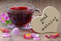Vitamins tea. good morning. hibiscus tea and wild roses on a wooden table. heart symbol of love. Vitamins tea. good morning. hibiscus tea and wild roses on a Royalty Free Stock Images