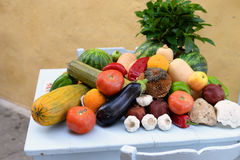 Vitamins vegetable still life. Beautiful rich colorful still life made of fruit and vegerables placed on a white wooden table Royalty Free Stock Photo