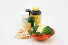 Vitamins & Vegetables Royalty Free Stock Images