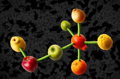Vitamins for you and me. Connected fruits in the shape of molecular structure. Concept for vitamins diet Stock Image