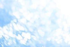 Vitbokeh på blåttbakgrund Royaltyfri Foto