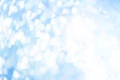 Vitbokeh på blåttbakgrund Royaltyfria Bilder