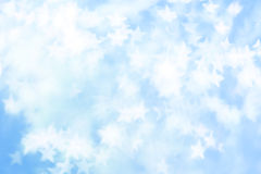 Vitbokeh på blåttbakgrund Royaltyfri Bild