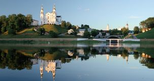 Vitebsk, Belarus. Assumption cathedral church, town hall, church of Resurrection Of Christ and Dvina River in summer. Evening Time stock video