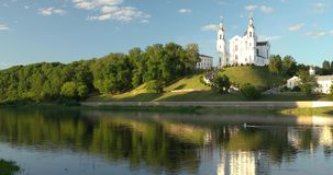 Vitebsk, Belarus. Assumption Cathedral Church, Town Hall, Church Of Resurrection Of Christ And Dvina River In Sunny. Summer Day. Pan, Panorama stock footage