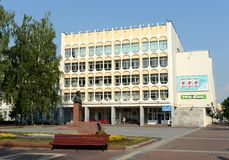 Vitebsk Regional Scientific and Technical Library and a monument to Petr Masherov. VITEBSK, BELARUS - AUGUST 11, 2015:Vitebsk Regional Scientific and Technical Stock Photos