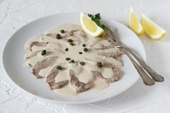 Vitello tonnato is a traditional italian dish on a white concrete background. royalty free stock photography