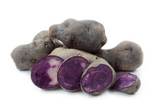 Vitelotte blue-violet potato Stock Images