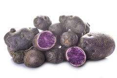 Vitelotte or blue-violet potatoes Stock Photo