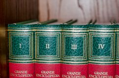 Viterbo 18/03/2018 books of an encyclopedia. Books of an encyclopedia with numbered volumes with Roman numerals stock photos