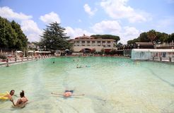People relax in natural hot pool of Terme dei Papi meaning Spa. VITERBO, ITALY - JULY 24 2016: People relax in natural hot pool of Terme dei Papi meaning Spa of royalty free stock photography