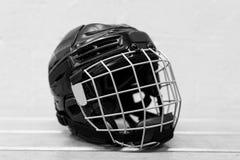 Vitesse d'hockey du ` s d'enfant : casque Images libres de droits