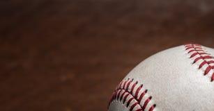 Vitesse de base-ball de vintage sur un fond en bois Images stock