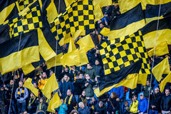 Vitesse supporters with yellow black flags Stock Photography