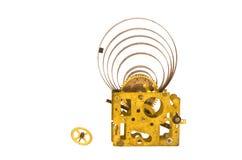 Vitesses en laiton d'horloge antique et élément fondamental en acier d'isolement images libres de droits