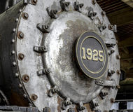 Vitesses et roues de vieille machine à vapeur dans B&W Image stock