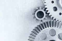 Vitesses industrielles pour des machines sur le plan rapproché gris de fond en métal image stock